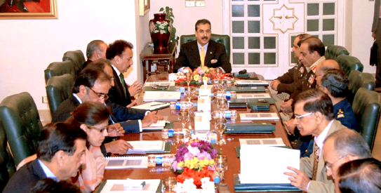 December 03 - PM Gilani chairing the meeting of DCC in Islamabad. The most powerful man present in the meeting is hardly visible in this picture.